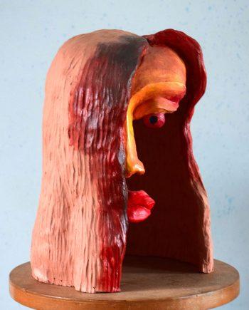 Kolorovaná plastika hlavy